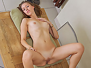 Teen Bianca spreads her long legs and finger fucks her juicy pussy
