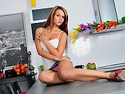Pretty college girl masturbates atop the kitchen counter