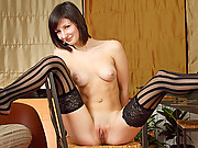 Sexy short haired brunette takes an orgasmic ride on a dildo