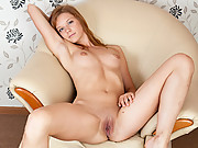 beautiful brunette Nubile Emi gets off with her fingers