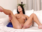 Hot babe Nina Lee pummels her pink fuck box with a dildo